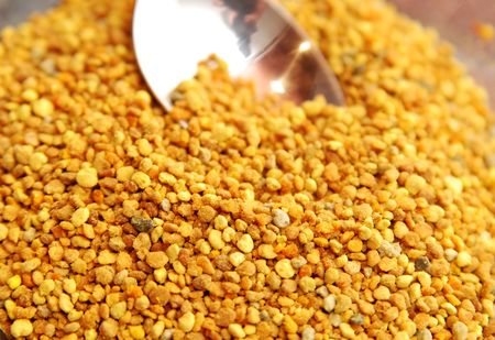Bee pollen granules.Close up picture photo