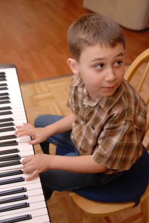 Piano practise,Young 6-7 Year old Boy playing Piano
