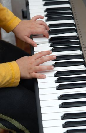 Piano practise,A young 6-7 Year old Boy playing the Piano.Hands only