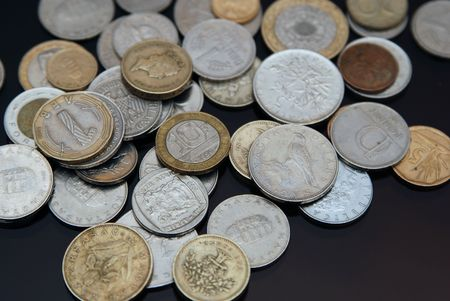 Coins from all over the world.Foreign and domestic currency. Stock Photo - 2997387