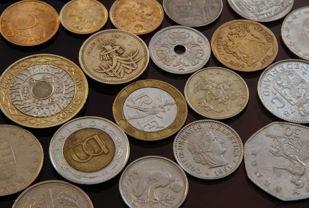 Coins from all over the world.Foreign and domestic currency. Stock Photo