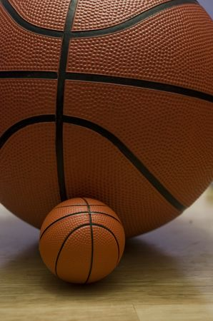 Young talent.Regular size and miniature basketballs Stock Photo - 3207621