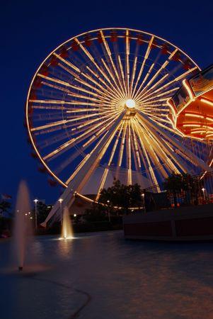 Ferris Wheel and Carousel at Night photo