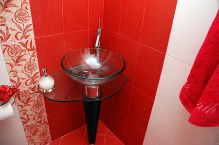 Closeup of a fancy Bathroom in red and white