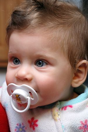 Closeup portrait of adorable baby  with Pacifier