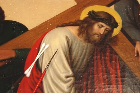 Over a hundred year old oil painting in a restoration process.One of the stations of the Cross depicting the journey of Jesus. Archivio Fotografico