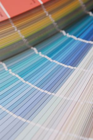 uncoated: Stock photo of a Paint swatches fanned out to reveal various colours .Color guide