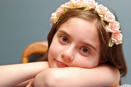 Cute little girl with  flowers in Her hair