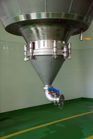 Bottom end of very large stainless steel tank of beer. Stock Photo - 5266521