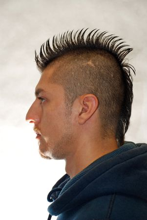 Profile portrait of a  man with spiked Mohawk .