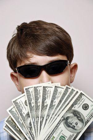 Money Man.Boy holding a fan of one hundred dollar bills