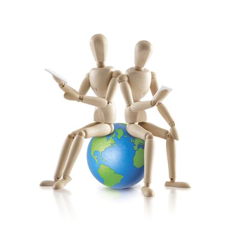 i pad: 2 Wood model sit on the world on white background