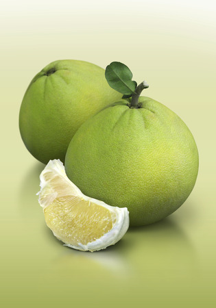Pomelo on green background