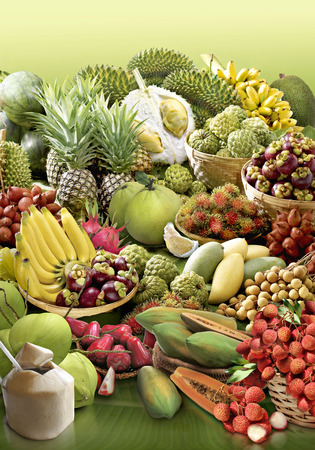 fruits in a basket: tropical fruit on banana leaf background Stock Photo