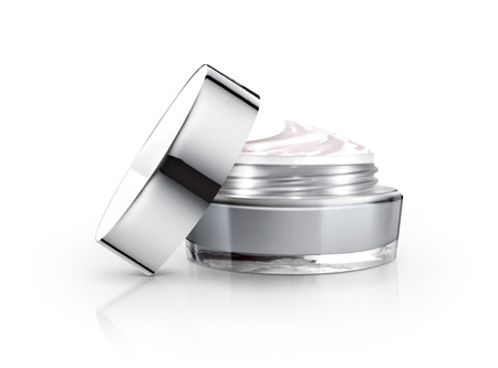 gray cosmetic jar and cream on white background