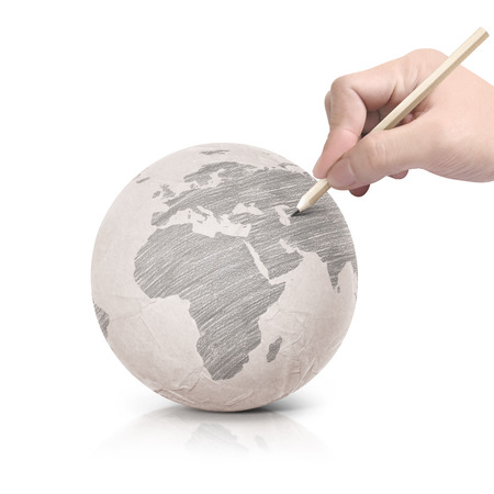 Shade drawing Europe map on paper ball on white background Stock Photo