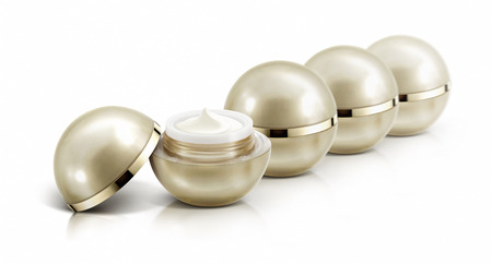 Several golden sphere cosmetic jar on white background Standard-Bild
