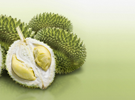 savour: Durian on green solid background Stock Photo