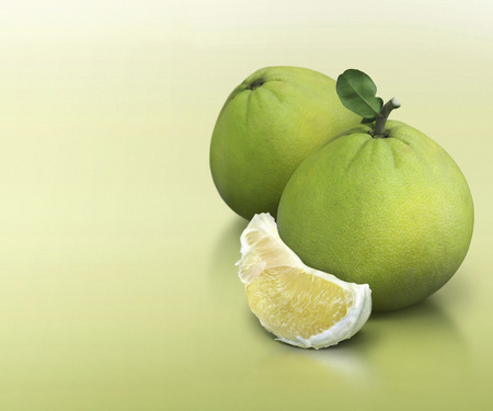 solid background: Pomelo on green solid background