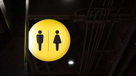 Circle lightbox restroom signage hang on wall