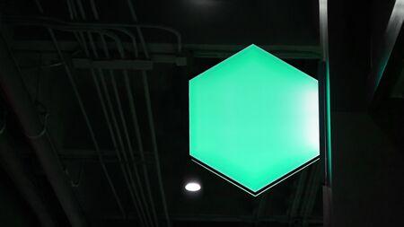 Blank hexagon lightbox signage hang on wall