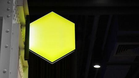 Blank hexagon lightbox signage hang on wall Standard-Bild - 138706648