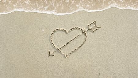 Symbol written in the sand on the beach