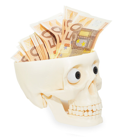 Paper money banknotes of 50 euros in an open white skull. Isolate. Stock Photo