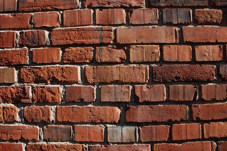 Brick walls with crumbling clay bricks, old wall bricks.