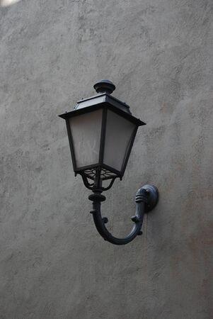 Antique Lamp hanging on grunge walls.