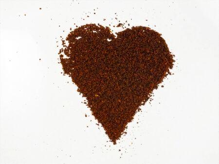 Coffee heart shape, made from ground coffee.