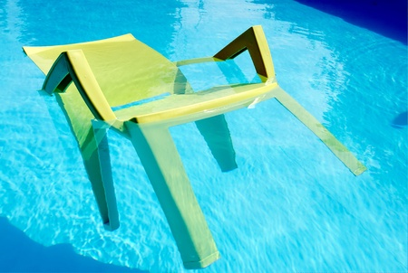 A cool chair floating in  swimming pool
