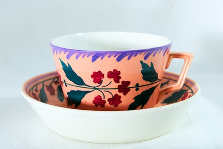 Antique cup in beautiful colours Stock Photo