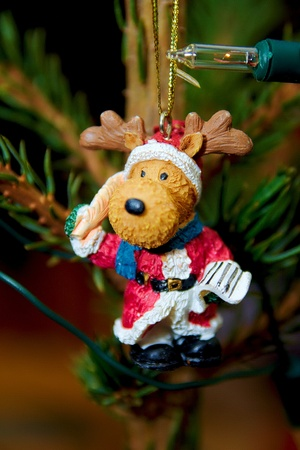 Reindeer in Christmas tree as colorful decoration photo