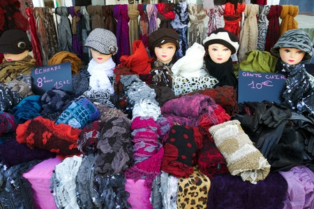 colurfull shop in France with hats, shawls and gloves, summer sales