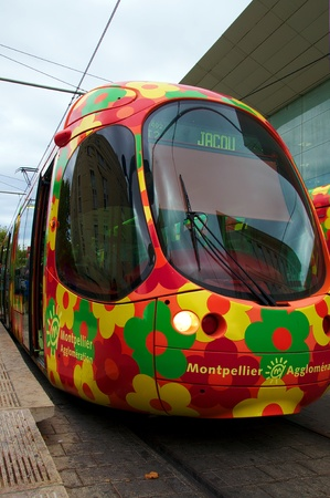 tramway in Montpellier France with orange flowers decorated  trams  Editorial