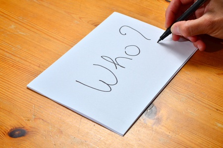 Writing on white paper with black ink the word who ? Stock Photo - 13291069