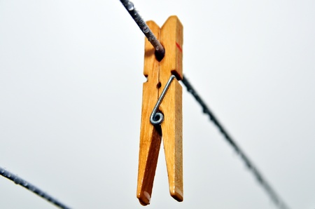 Clothes-pin on a rainy laundry day photo