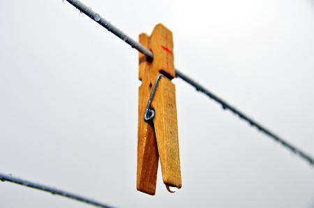 Clothes-peg on a rainy laundry day Stock Photo