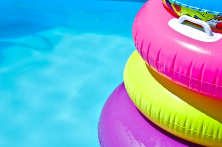 Inflatable colorful tubes in swimming pool Stock Photo
