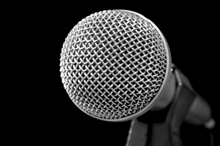 Silver shiny microphone on black