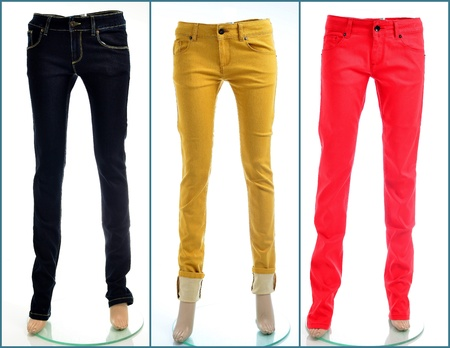red jeans: Colored denim jeans in black, yellow and red Stock Photo