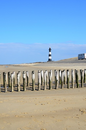Lighthouse on the beach of Breskens in  Holland with camping car Stockfoto