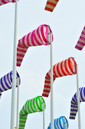 Colorful windsocks in yachting port photo