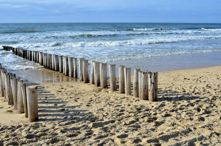 breakwaters in waves on  the beach at the north sea in Domburg Holland Stock Photo