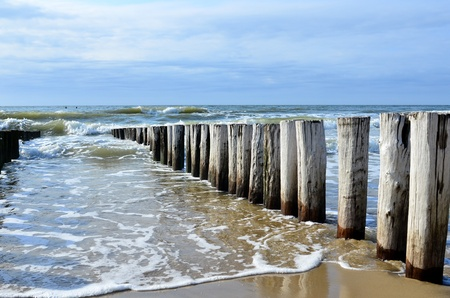 breakwaters: breakwaters in waves on  the beach at the north sea in Domburg Holland Stock Photo