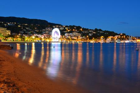 var: Beach and village at night  in le lavandou  var cote dazur provence, France Stock Photo
