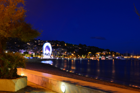 Beach and village at night  in le lavandou  var cote d'azur provence, France Stock Photo