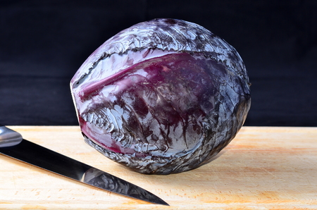 red cabbage: Red cabbage and a knife Stock Photo