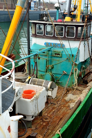 Fishing boat for North Sea shrimps close up installation and nets  photo